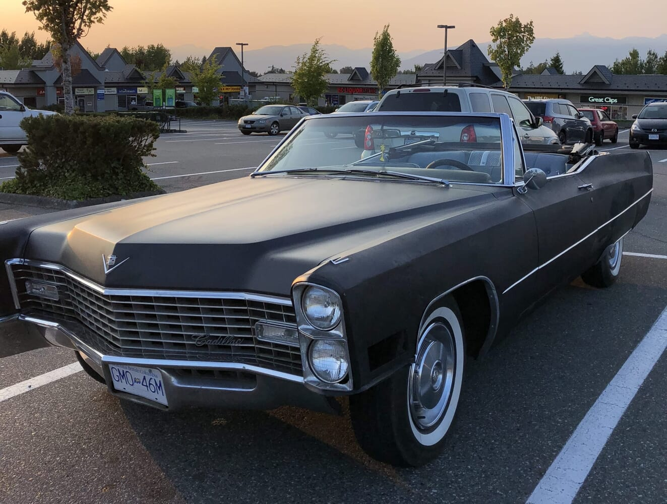 1967 Deville with flat black paint and shiny new white walls.