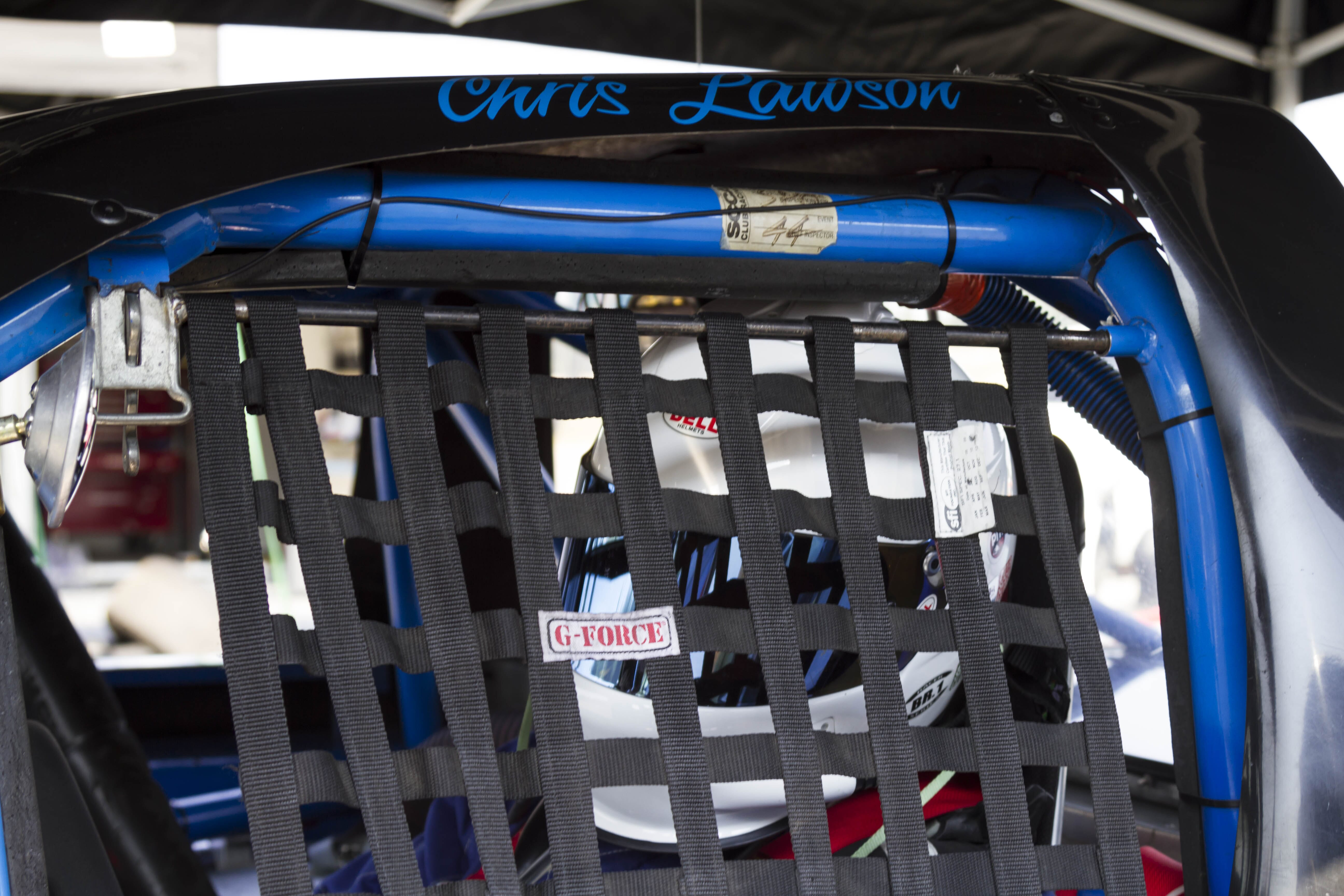 Buckled up, helmet on, cage secured, ready to race!