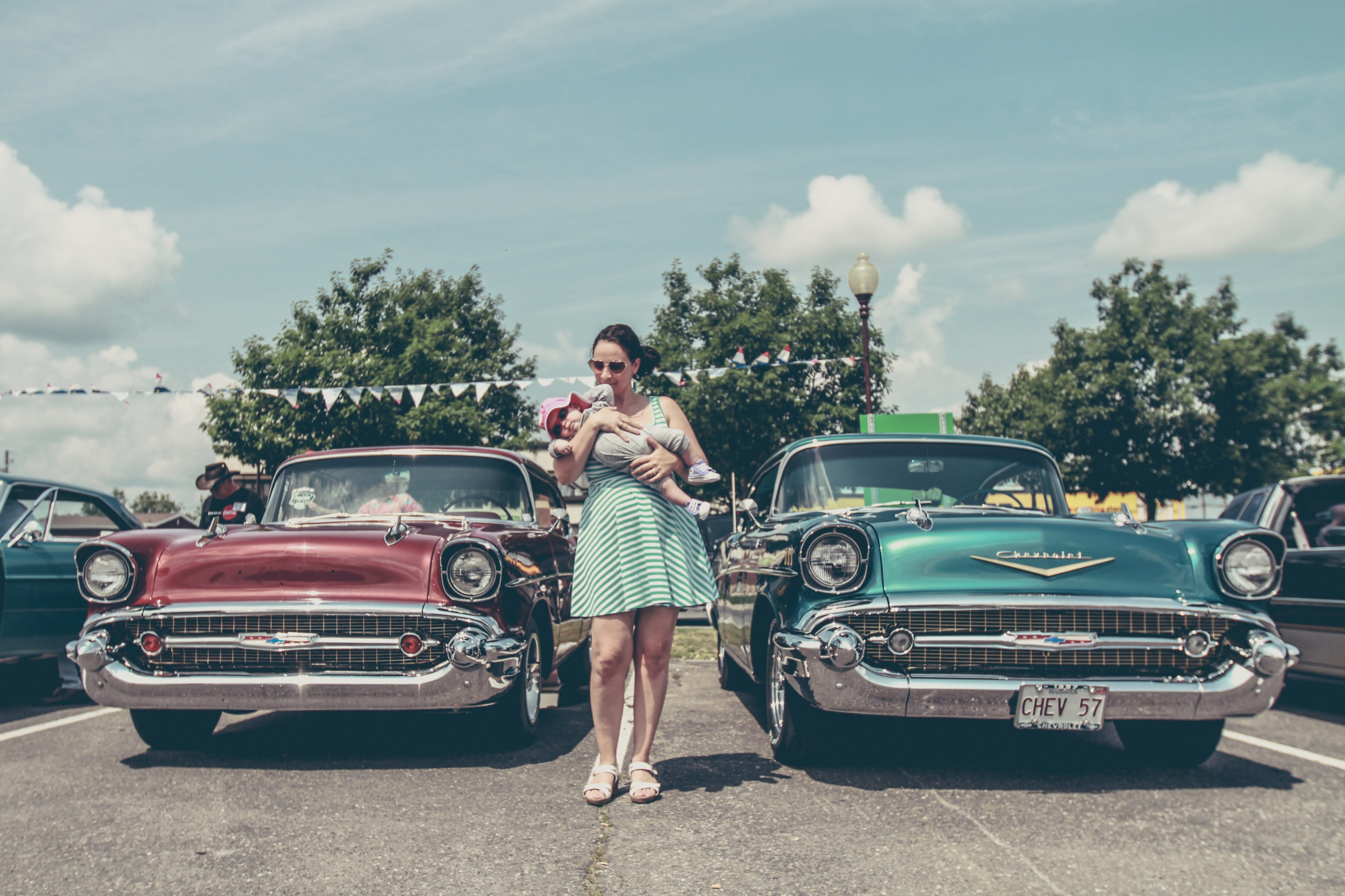 Lady and her son walking through a car show.
